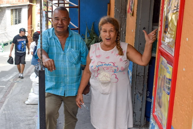 Man and woman standing on a porch in Medellin