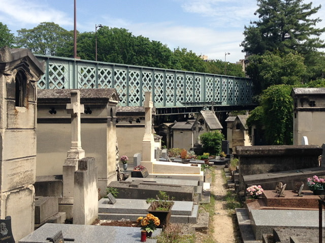 A bridge overlooking mausoleums and tombs
