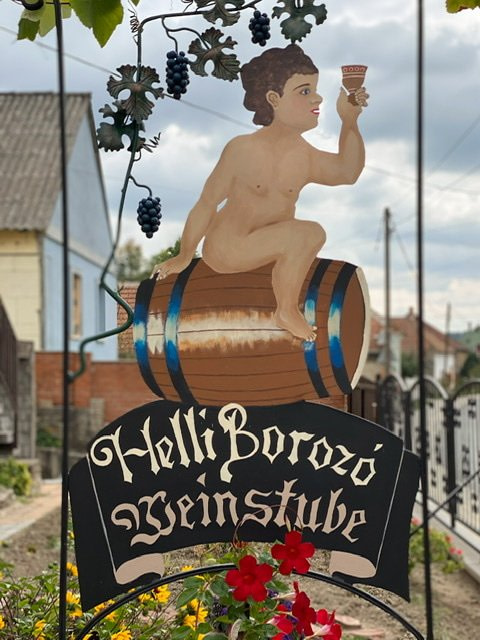 A sign for a winery and guest house in Egerszalok, Hungary