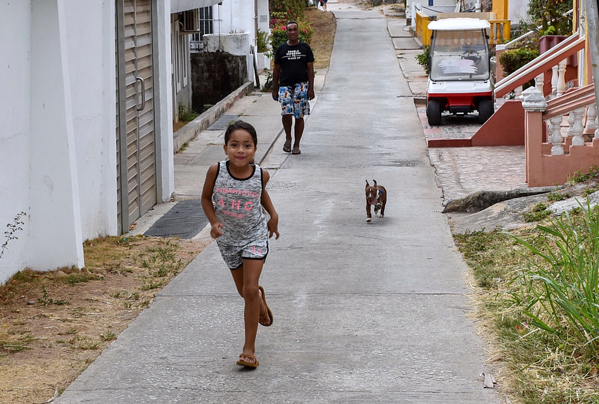 Girl running with small dog