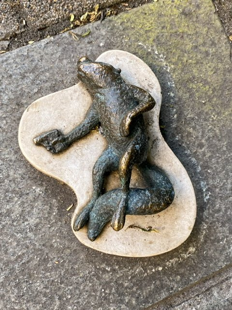 Mini statue of a dead squirrel with a gun