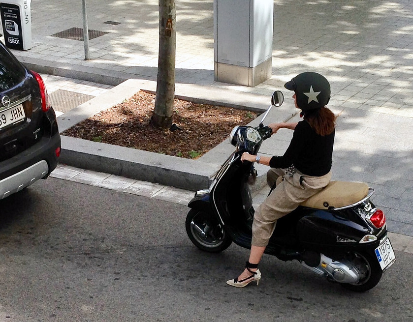 Young woman with high heels on a scooter