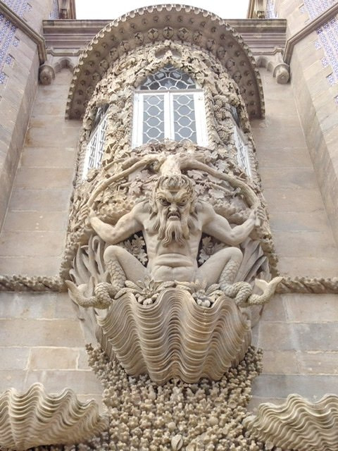 Gargoyle-like creature on the outside of a building