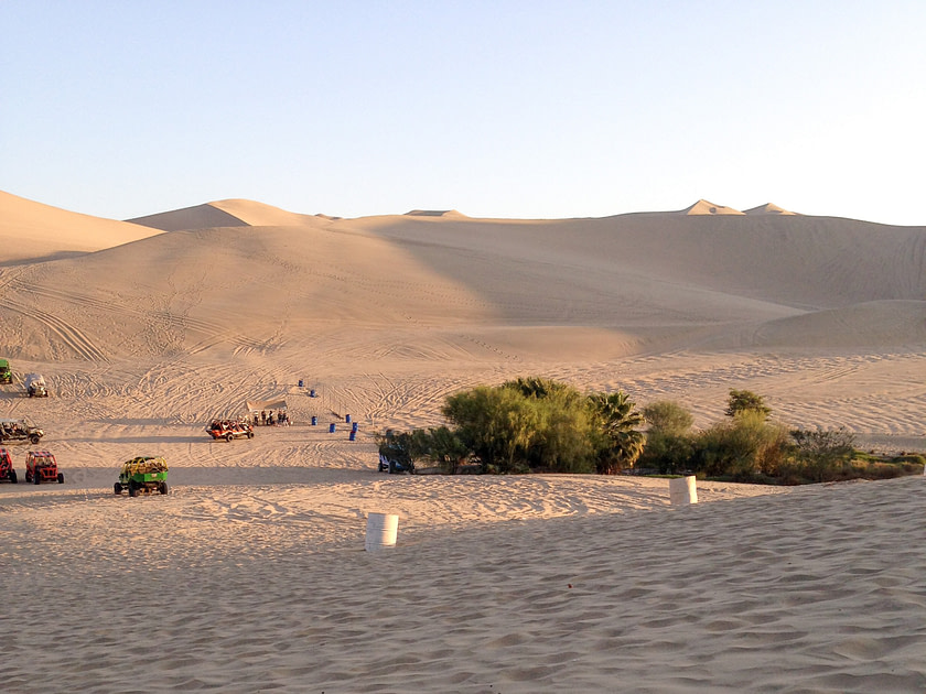 Dune buggies on sand dunes in Huacachina, Peru