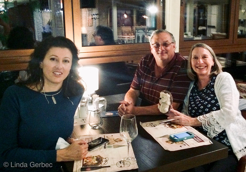 Three people at a restaurant