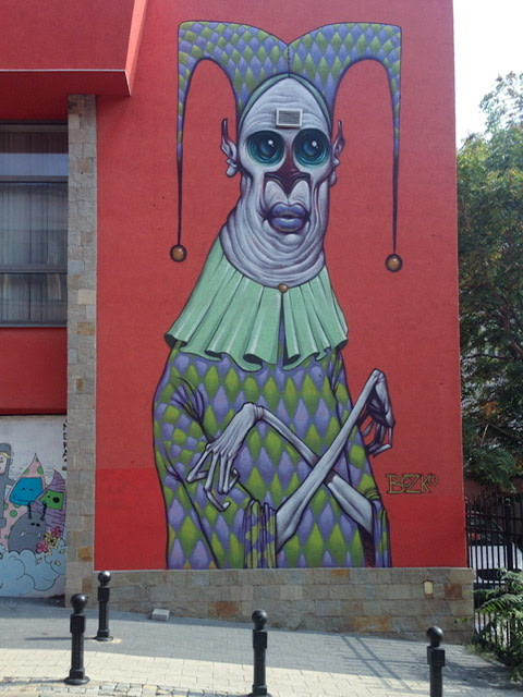 Mural of a creepy jester with skeleton arms