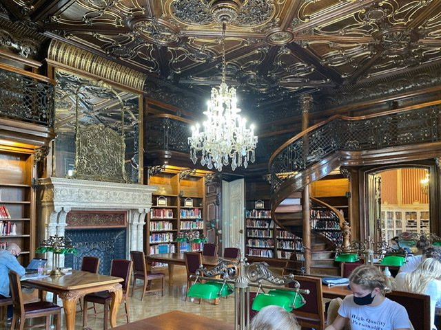 A dark, ornate room in the Szabo Ervin Library in Budapest