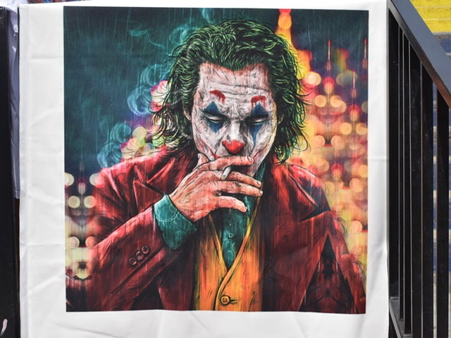 Mural of the Joker smoking a cigarette