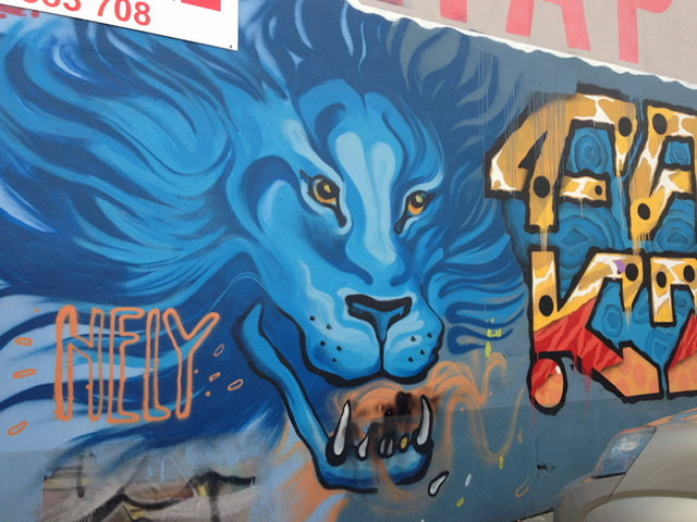 Mural of a blue lion with bared teeth