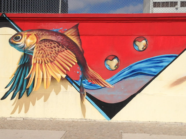 Mural of golden fish jumping out of water