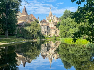 The Vajdahunyad Castle reflected in a pond