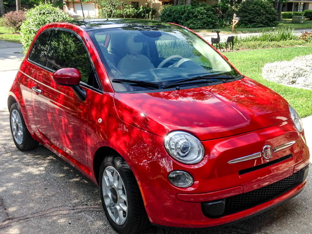 Red Fiat 500 in driveway