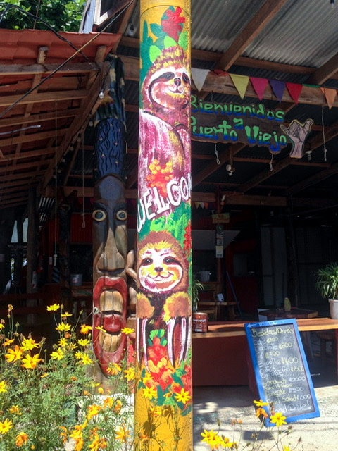 Pole decorated with paintings of sloths
