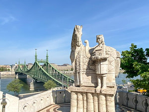Statue of King Saint Stephen with a horse overlooking the Liberty Bridge in Budapest