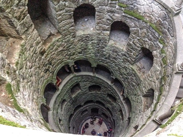 Looking down into a large initiation well