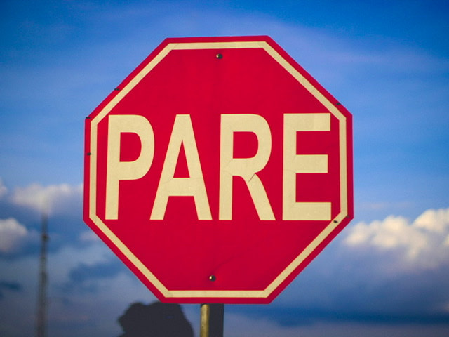Stop sign in Spanish