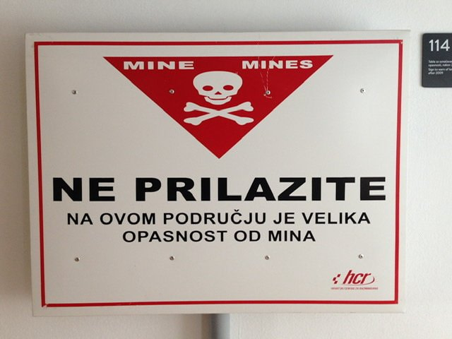 A sign warning of danger from mines in Croatian