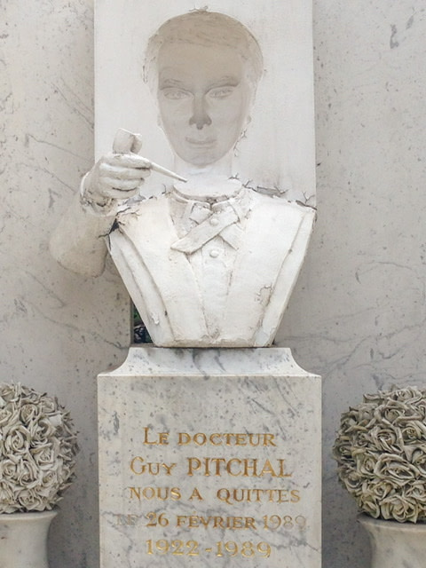 Tombstone with a man's bbust. His face is in revese relief