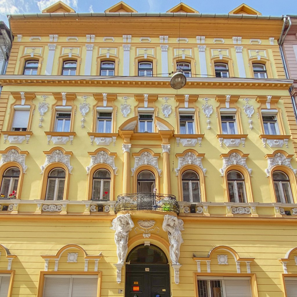 Bright yellow building with ornate white decorations