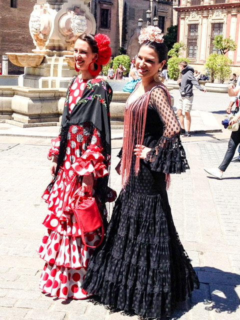Two young women in traditional dress in Seville, Spain