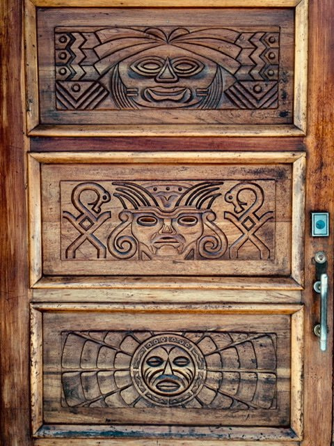 Wooden door with Inca style carvings