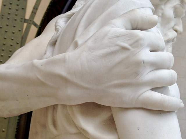 Detail of a hand on an arm of a statue