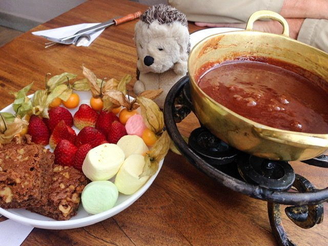 Chocolate fondue with items to dip