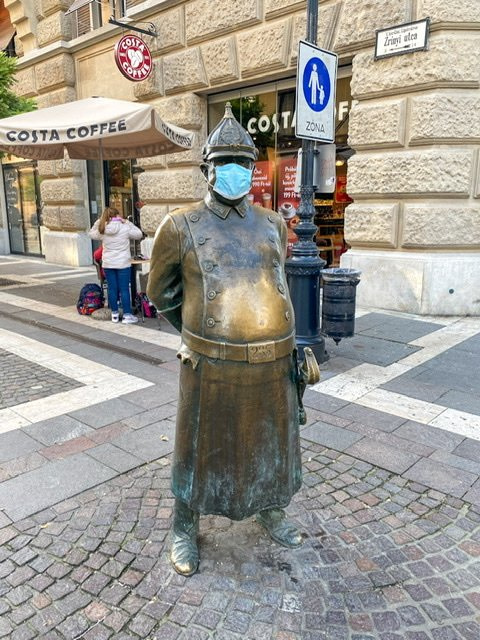 Statue of a policeman with a large belly