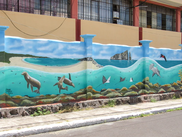 Mural looking out to sea from the Galapagos shore with sea life and a frigate bird