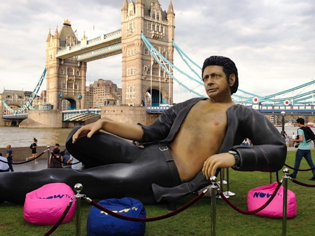 A large statue of Jeff Goldblum with the Tower Bridge in the background