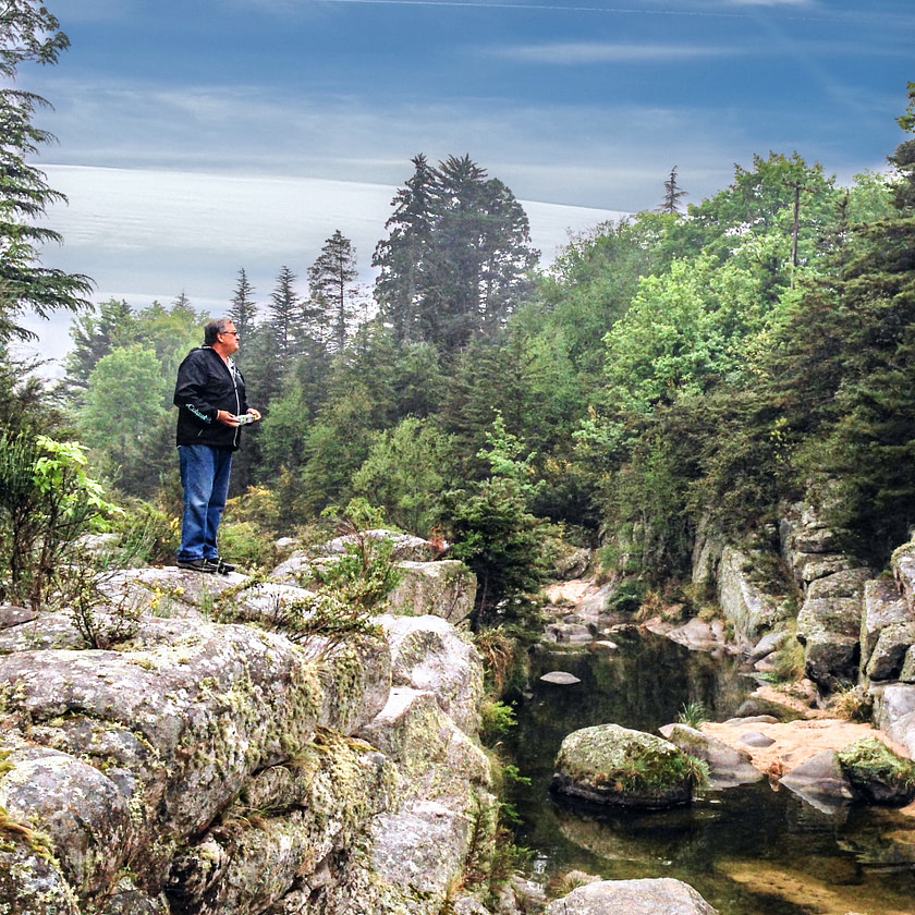 Steve standing on a rock in the river