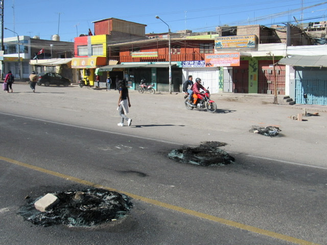 A street with remnants of burning tires.