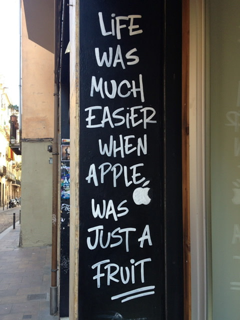 "A sign that reads ""Life was much easier when apple was just a fruit"""