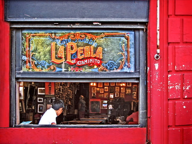 The window of the La Perla bar
