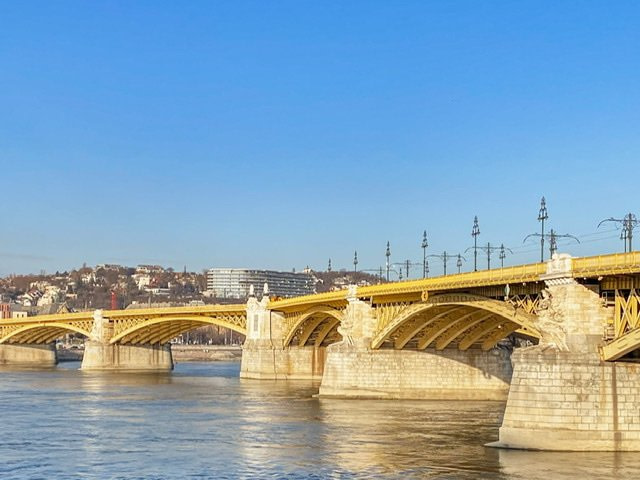 A yellow bridge spanning the Danube River