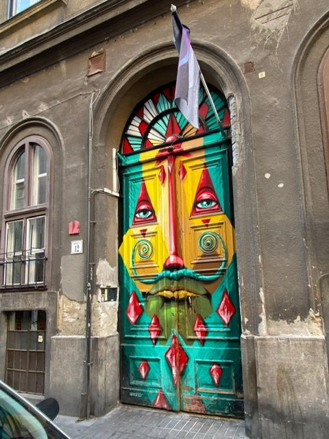 A door painted with a colorful and zany face