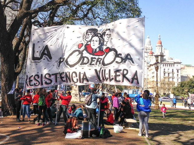 Protesters with a huge sign in Buenos Aires