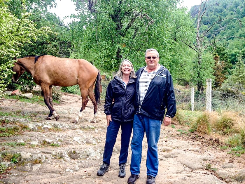 Steve and I with a horse in the background
