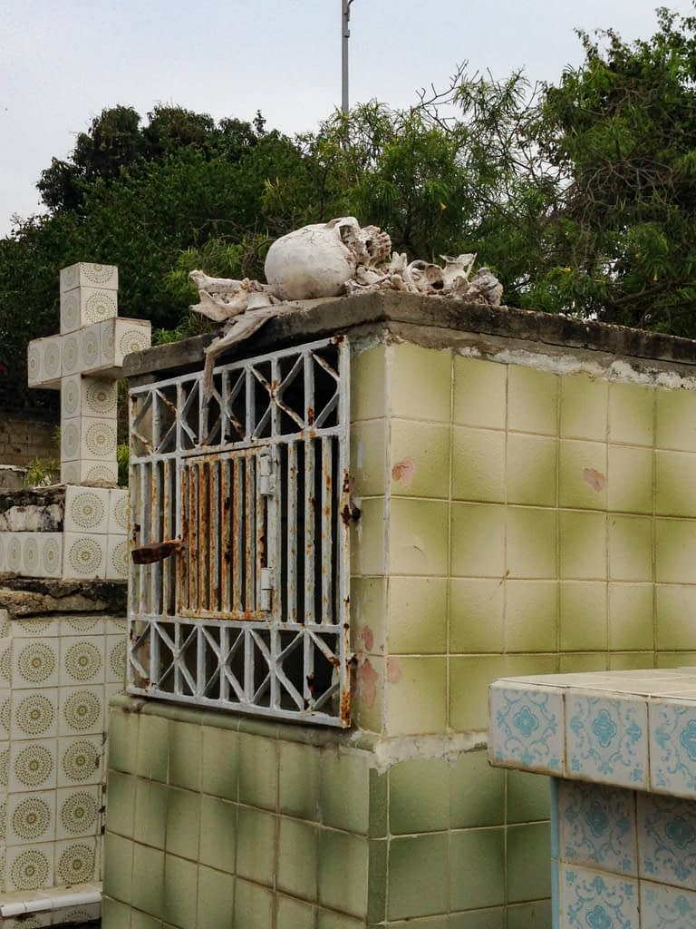 Tomb with skeleton on top