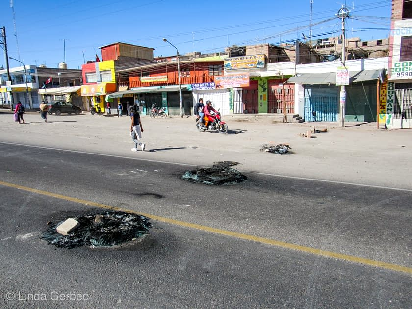 Street with remnants of burnt tires